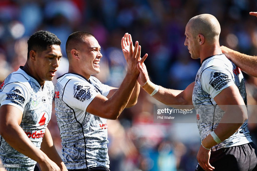Tuimoala Lolohea of the Warriors (L) celebrates his try during the 2016 Auckland Nines semifinal match between the Warriors and the Titans at Eden Park on February 7, 2016 in Auckland, New Zealand.