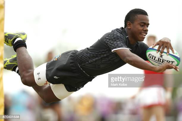 Tuiwainieli Camaibau of Fiji dives to score a try during the boy's rugby 7's bronze medal final match between Fiji and Canada on day 4 of the 2017...