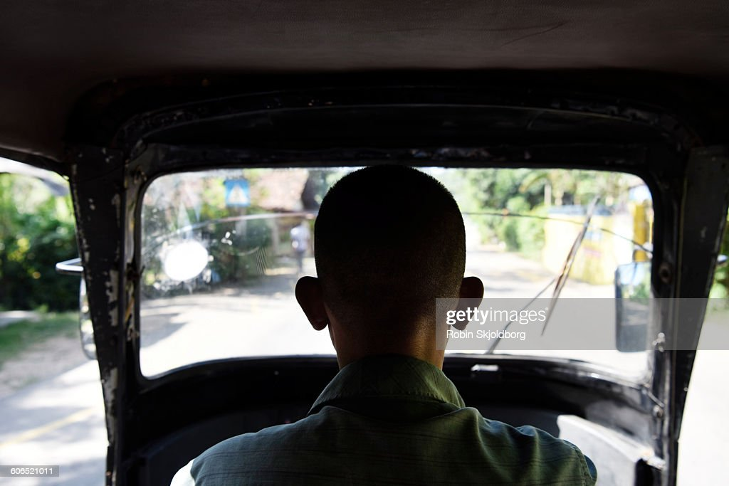 Tuk Tuk driver from behind with big ears