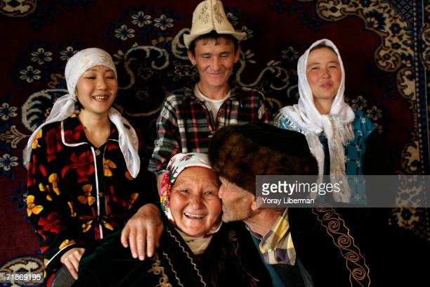 Tukun Saburuv and his wife Burulkan sit while their daughter son and his wife stand behind in the kitchen of their home April 2 2005 in Ismail...