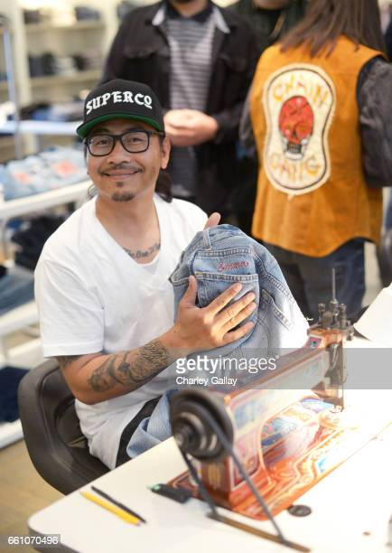 Tul Jutargate of The Chain Gang team customizing pieces at Barneys New York x Chain Gang Residency at Barneys New York Beverly Hills on March 30 2017...
