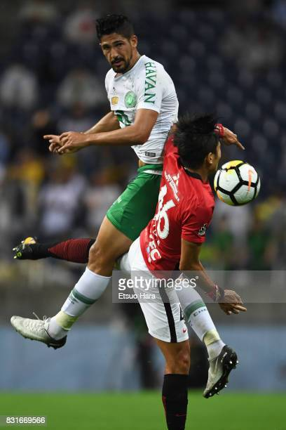 Tulio de Melo of Chapecoense and Ryota Moriwaki of Urawa Red Diamonds compete for the ball during the Suruga Bank Championship match between Urawa...