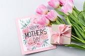 beautiful pink tulips, happy mothers day postcard and gift