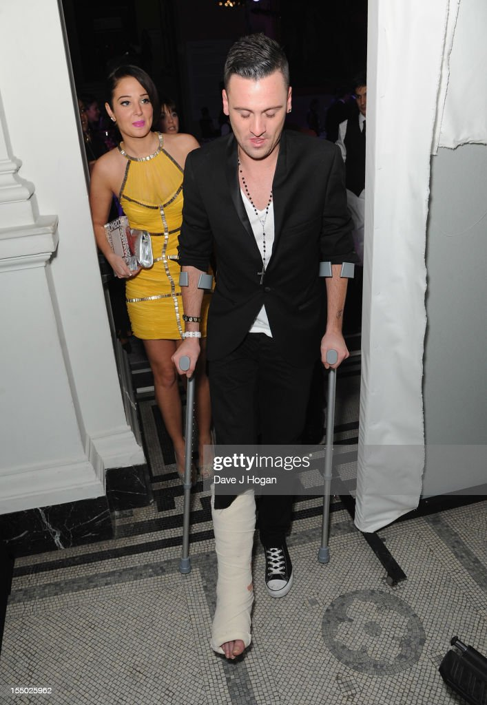 <a gi-track='captionPersonalityLinkClicked' href=/galleries/search?phrase=Tulisa+Contostavlos&family=editorial&specificpeople=6544720 ng-click='$event.stopPropagation()'>Tulisa Contostavlos</a> and Gareth Varey attend the Cosmopolitan Ultimate Woman of the Year Awards after party at Victoria & Albert Museum on October 30, 2012 in London, England.