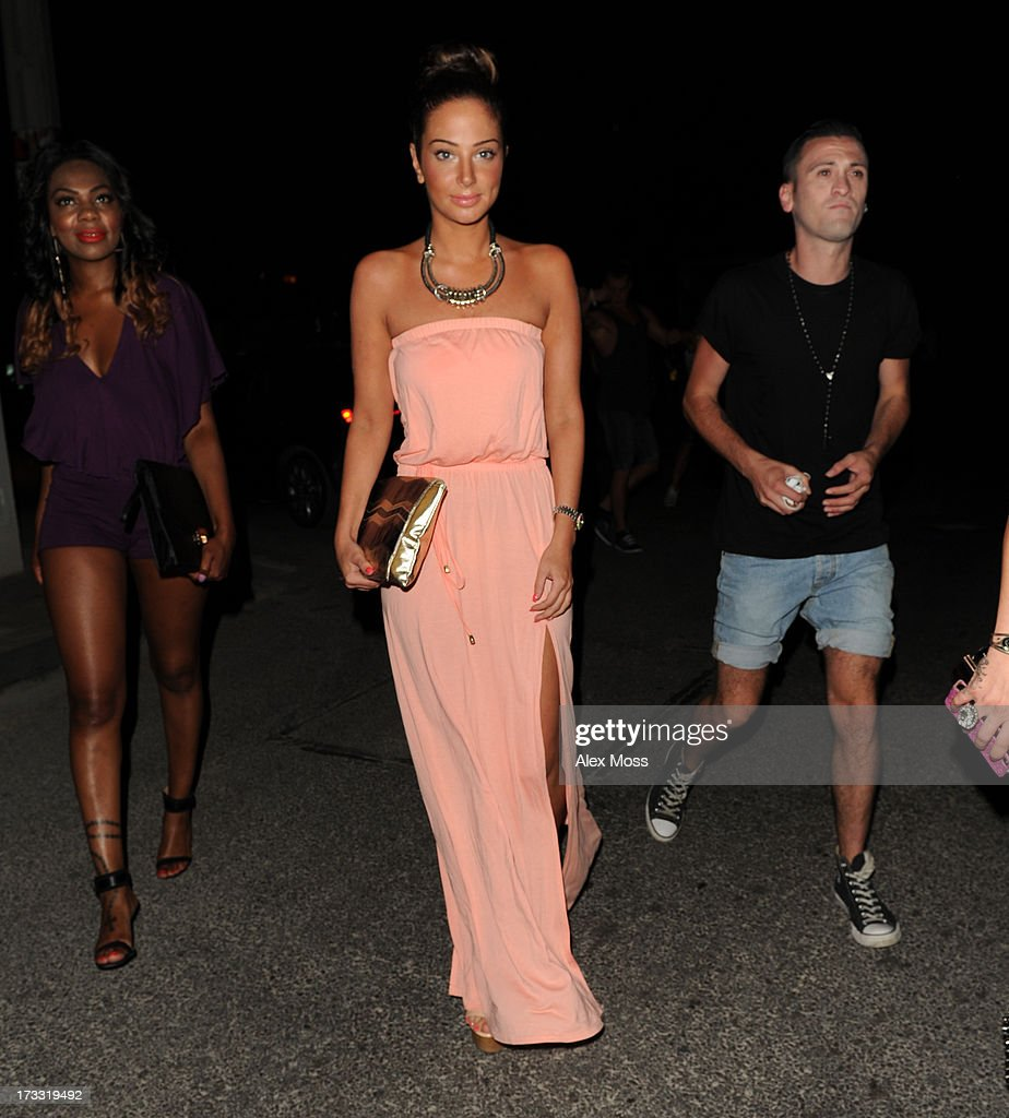 Tulisa Contostavlos out for dinner with her friend in San Antonio on July 12, 2013 in Ibiza, Spain.