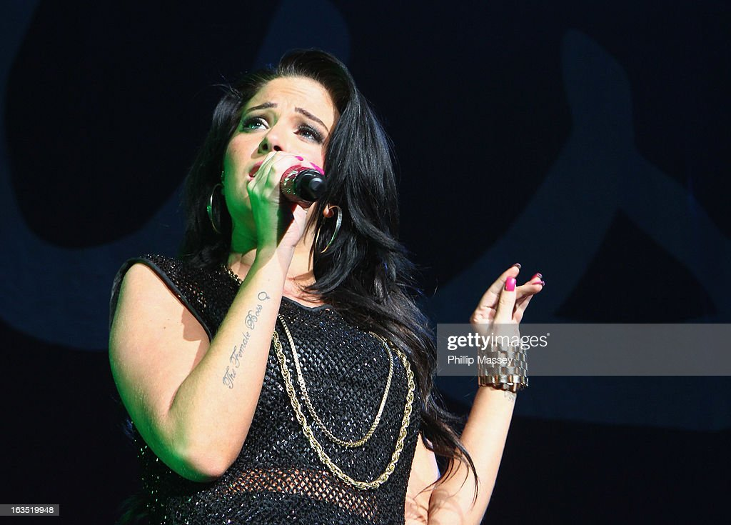 <a gi-track='captionPersonalityLinkClicked' href=/galleries/search?phrase=Tulisa+Contostavlos&family=editorial&specificpeople=6544720 ng-click='$event.stopPropagation()'>Tulisa Contostavlos</a> performs as support act for Ne-Yo at the 02 on March 11, 2013 in Dublin, Ireland.