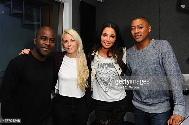 Tulisa Contostavlos poses with Kiss FM DJ's Melvin O'Doom Charlie Hedges and Ricky HaywoodWilliams as she visits Kiss FM Studio's on October 23 2014...
