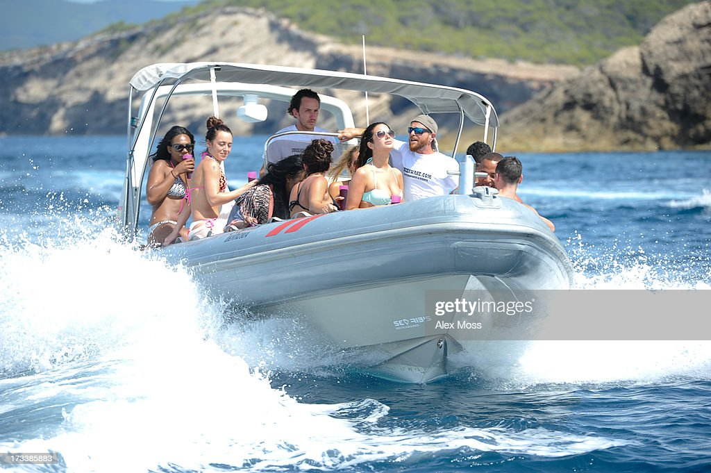 <a gi-track='captionPersonalityLinkClicked' href=/galleries/search?phrase=Tulisa+Contostavlos&family=editorial&specificpeople=6544720 ng-click='$event.stopPropagation()'>Tulisa Contostavlos</a> rents a boat and tours the island drinking sangria with her friends in a mint colour bikini on July 12, 2013 in Ibiza, .