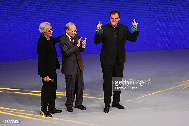 Tullio Solenghi Ennio Morricone and Quentin Tarantino attend the '2015 David Di Donatello' Awards Ceremony at Teatro Olimpico on June 12 2015 in Rome...