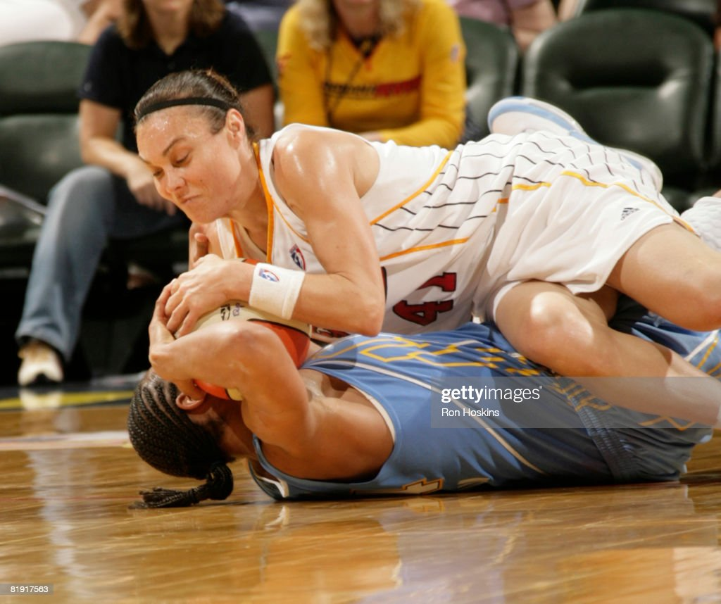 Tully Bevilaqua of the Indiana Fever fights for the ball against a Chicago Sky defender at Conseco Fieldhouse on July 12 2008 in Indianapolis Indiana...
