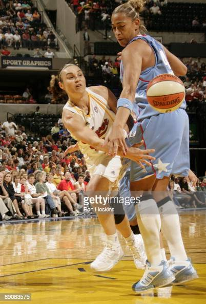 Tully Bevilaqua of the Indiana Fever passes around Erika de Souza of the Atlanta Dream at Conseco Fieldhouse on July 17 2009 in Indianapolis Indiana...