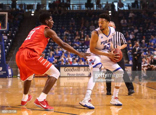 Tulsa Golden Hurricane Guard Corey Henderson Jr waits for the pick to be set on Houston Cougars Guard Damyean Dotson during the AAC Mens basketball...