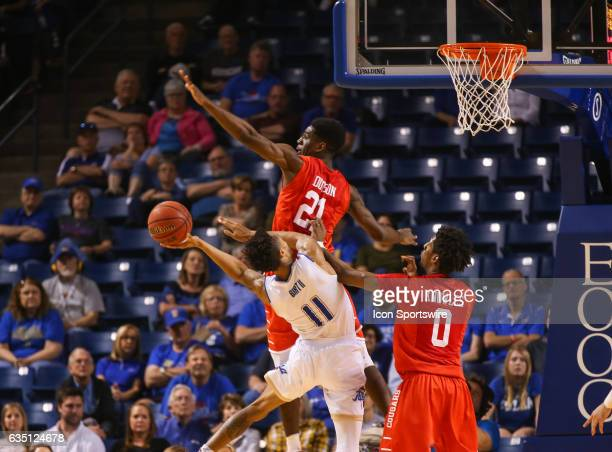 Tulsa Golden Hurricane Guard Pat Birt tries an acrobatic shot over Houston Cougars Guard Damyean Dotson during the AAC Mens basketball game between...