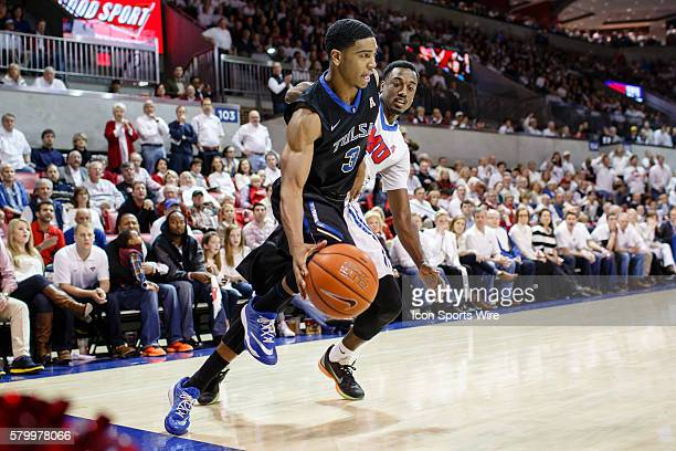 Tulsa Golden Hurricane guard Shaquille Harrison drives the baseline around Southern Methodist Mustangs guard Ryan Manuel during the NCAA Basketball...