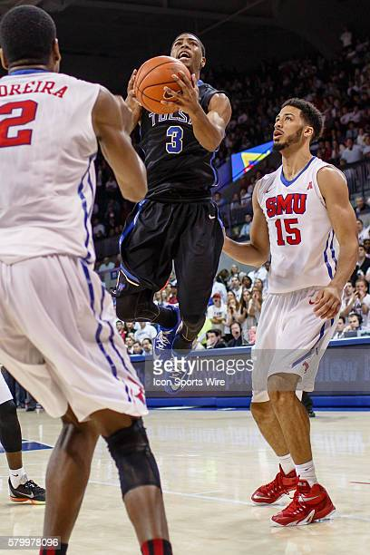 Tulsa Golden Hurricane guard Shaquille Harrison leaps between two Southern Methodist Mustangs defenders during the NCAA Basketball game between the...