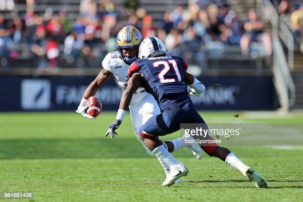 Tulsa Golden Hurricane wide receiver Justin Hobbs and UConn Huskies defensive back Jamar Summers in action during the second half of a college...