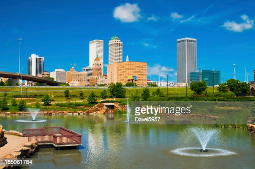 'Tulsa skyline, pond, and fountains'
