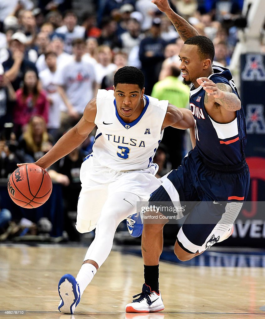 Tulsa's Shaquille Harrison is pressured by Connecticut's Ryan Boatright in the semifinals of the AAC Tournament at the XL Center in Hartford Conn on...