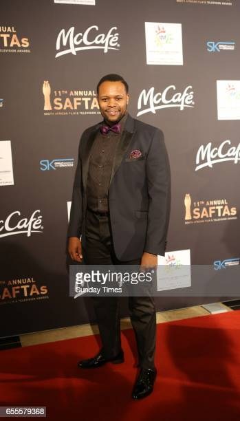 Tumisho Masha poses on the red carpet during the South African Film and Television Awards at Sun City on March 18 2017 in Rustenburg South Africa The...