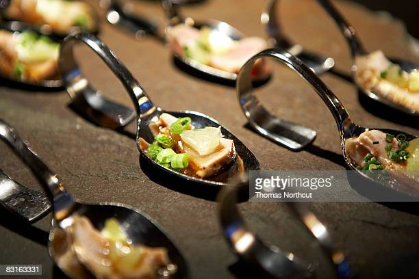 Tuna appetizer on spoons.