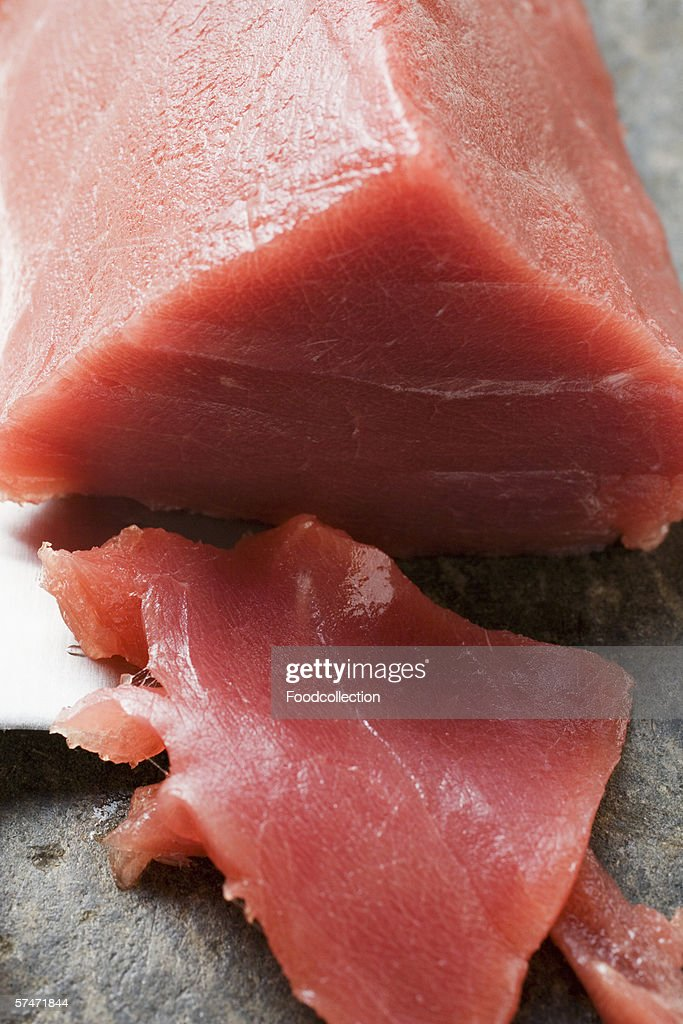 Tuna fillet, a piece cut off : Stock Photo