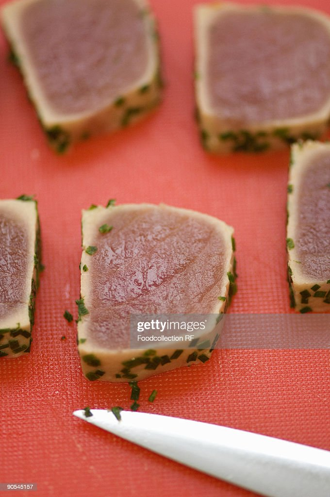 Tuna fillet slices with chives, close up