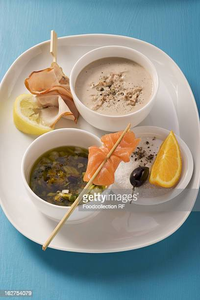 Tuna fish, white wine sauce, olive and caper marinade with oranges