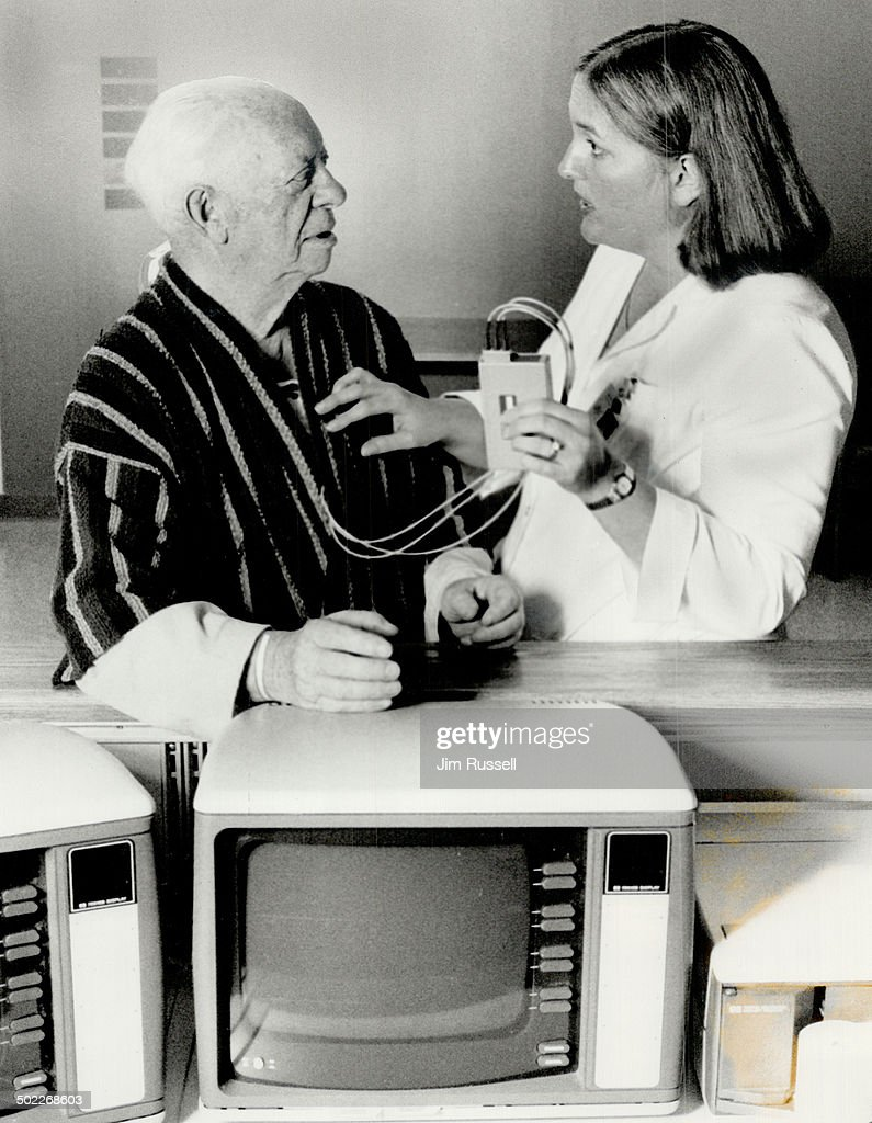 Tuned in Patient Jake Gold 84 is shown the operation of a transmitter sending out heart rate signals by nurse Sandy Wiesenthal at Baycrest Hospital