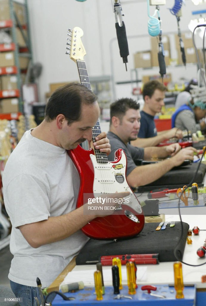 Tunertester Hector Sandoval makes the final adjustments on a Stratocaster guitar before packaging and shipping at the Fender manufacturing facility...