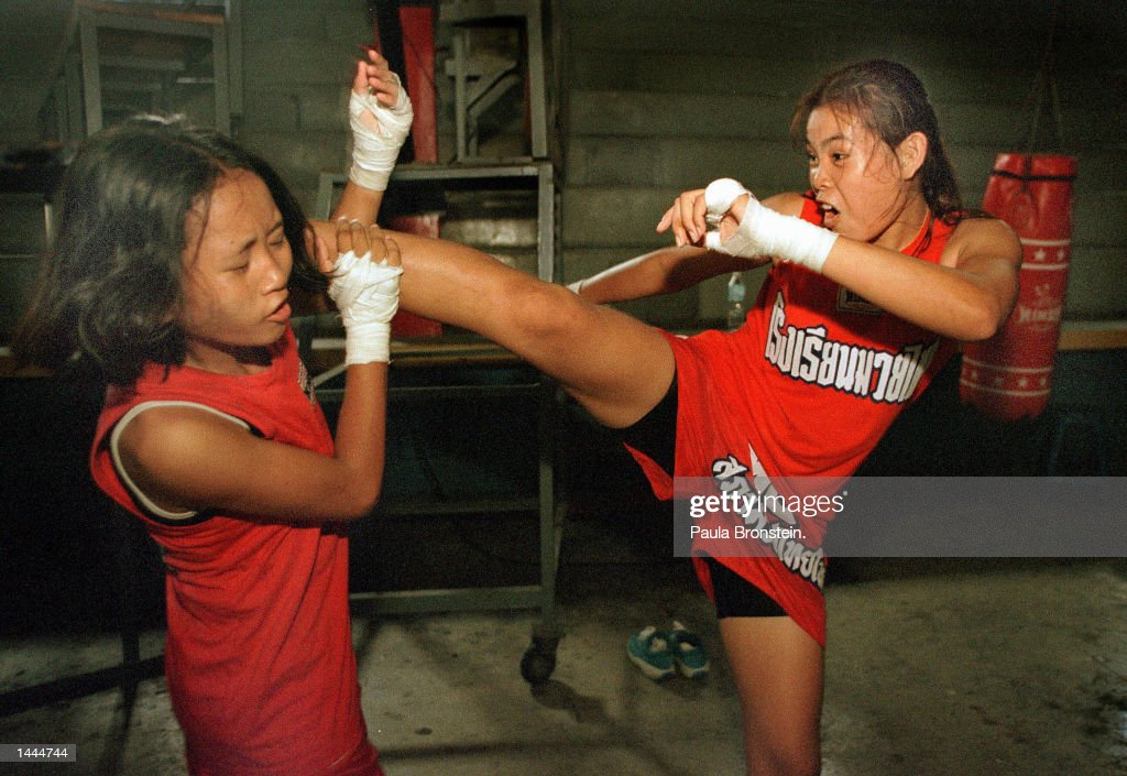 Tung, left, gets a hard kick by Featherweight champion Muay Thai boxer Rung-arun May, 2000 during practice at the Muaythai Institute (school of boxing) at Rangsit stadium in Bangkok,Thailand .