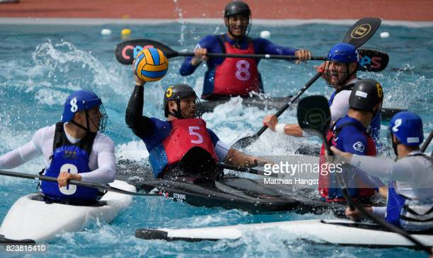 Tung Yang Wu of of Chinese Taipei breaks through the defence of France during the Canoe Polo Men's match between France and Chinese Taipei of The...