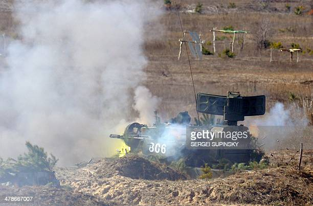 A Tunguska antiaircraft gunmissile system fire rounds during military drills held by the Ukrainian army not far from the small city of Goncharovskoye...