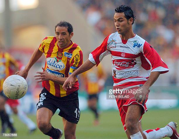 Club Africain player forward Zouheir Dhaouadi vies with Esperance de Tunis defender Mourad Melki during the Tunisia capital derby of Premiership...