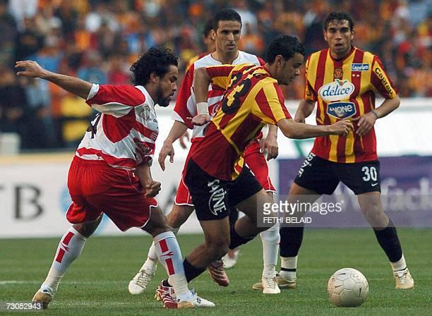 Esperance de Tunis midfielder Kamel Zaeim vies with Club Africain defender Ouartani during the Tunisia capital derby of Premiership football match at...