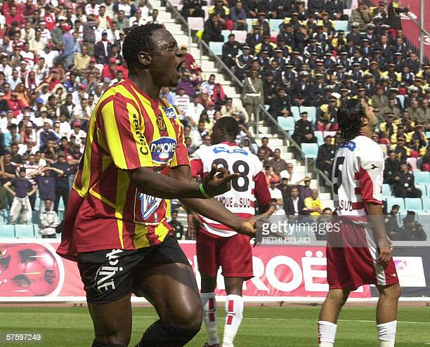 Esperance's striker Mickael Inramo jubiletes after scoring against Club Africain during their Tunisia Cup final football match Club AfricainEsperance...