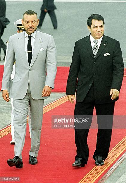Tunisan President Zine El Abidine Ben Ali and Morocco King Mohammed VI review an honour guard upon Mohammed VI arrival 24 May 2000 at Carthage...