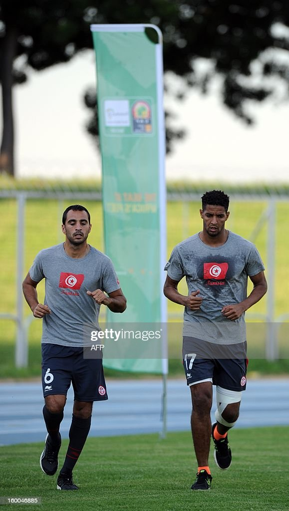 Tunisia defender Fatah Garbi and forward Issam Jemaa train on January 25, 2013 in Rustenburg on the eve of a 2013 African Cup of Nation Group D football match against Ivory Coast.