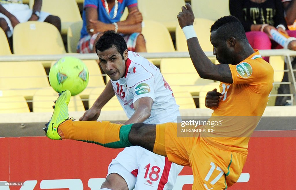 Tunisia Midfielder Chadi Hammami (L) vies with Ivory Coast defender Siaka Tiene during the 2013 African Cup of Nations football match Ivory Coast vs Tunisia in Rustenburg on January 26, 2013 at Royal Bafokeng Stadium in a Group D match. Ivory Coast won 3-0. AFP PHOTO / ALEXANDER JOE