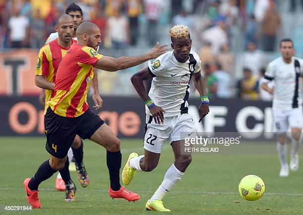 Tunisia CS Sfax striker Ibrahim Ndong dribbles past Esperance of Tunis player Houcine Ragued during their CAF Champions League football match on June...