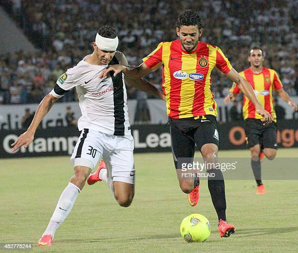 Tunisia CS Sfax striker Imed Louati vies with of Esperance of Tunis defender Mohamed Ali Yacoubi during their CAF Champions League football match on...