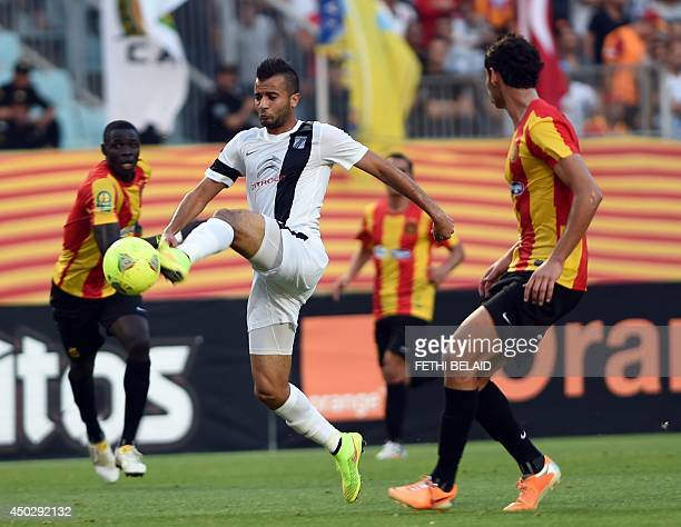 Tunisia CS Sfax striker Yassine Khnissi controls the ball ahead of Esperance of Tunis player Chamseddine Dhaouadi during their CAF Champions League...
