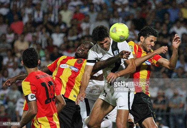 Tunisia CS Sfax striker Yassine Khnissi vies with Esperance of Tunis players Yannick Ndjeng and Mohamed Ali Yacoubi during their CAF Champions League...