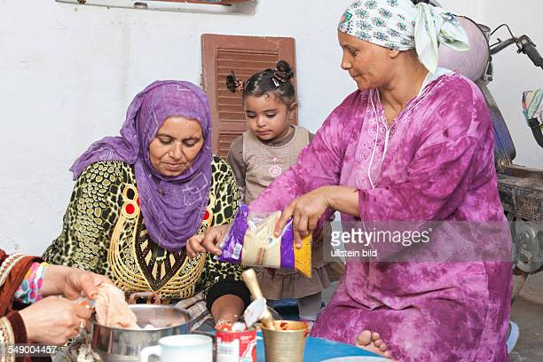 Sidi Mtir women in traditional clothing preparing the meal for Eid alAdha
