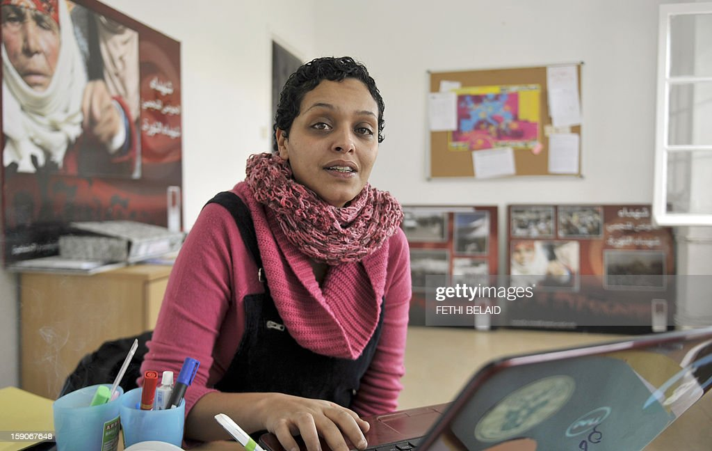 Tunisian blogger and journalist Olfa Riahi poses for photographers on January 7, 2013 in her office in Tunis. Riahi caused a scandal by accusing a Minister of Islamic influence of corruption and adultery, the blogger was banned from traveling and faces an open investigation at the request of the Minister, according to a judiciary source. AFP PHOTO / FETHI BELAID