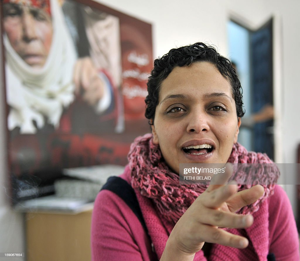 Tunisian blogger and journalist Olfa Riahi poses for photographers on January 7, 2013 in her office in Tunis. Riahi caused a scandal by accusing a Minister of Islamic influence of corruption and adultery, the blogger was banned from traveling and faces an open investigation at the request of the Minister, according to a judiciary source.