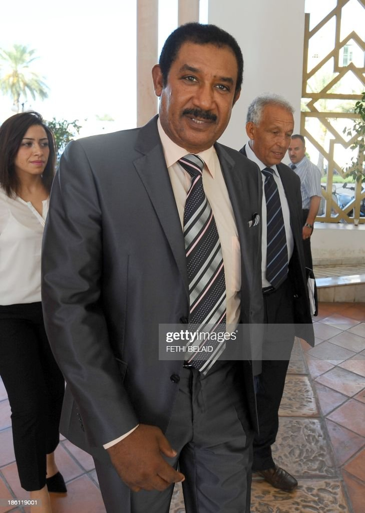 Tunisian candidate for prime ministry and businessman Mohamed Ayachi Ajroudi, arrives at a meeting as part of the dialogue between ruling Islamists and the opposition aimed at ending a two-month political crisis on October 28, 2013 in Tunis. Ennahda and the opposition signed a road map for the creation of a government of independents within three weeks. Tunisia was plunged into crisis in July when opposition politician Mohamed Brahmi was shot dead by suspected jihadist gunmen in circumstances similar to the murder of another opposition MP, Chokri Belaid, six months earlier. AFP PHOTO / FETHI BELAID