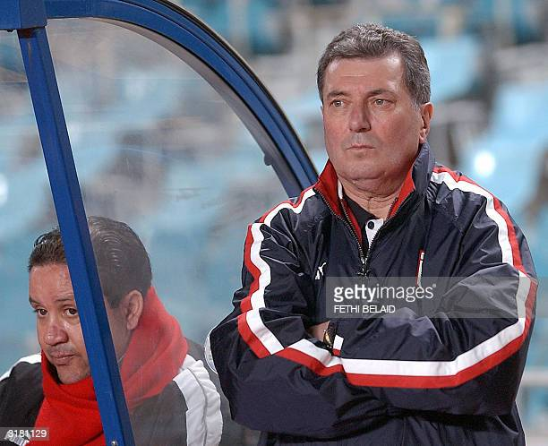 Tunisian coach French Roger Lemerre with his assistant Nabil Maaloul during their friendly football match against Ivory Coast at Rades Stadium in...