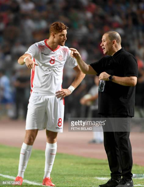 Tunisian coach Nabil Maaloul speaks with his player Fakhreddine Ben Youssef during their World Cup 2018 qualifying football match between Tunisia and...