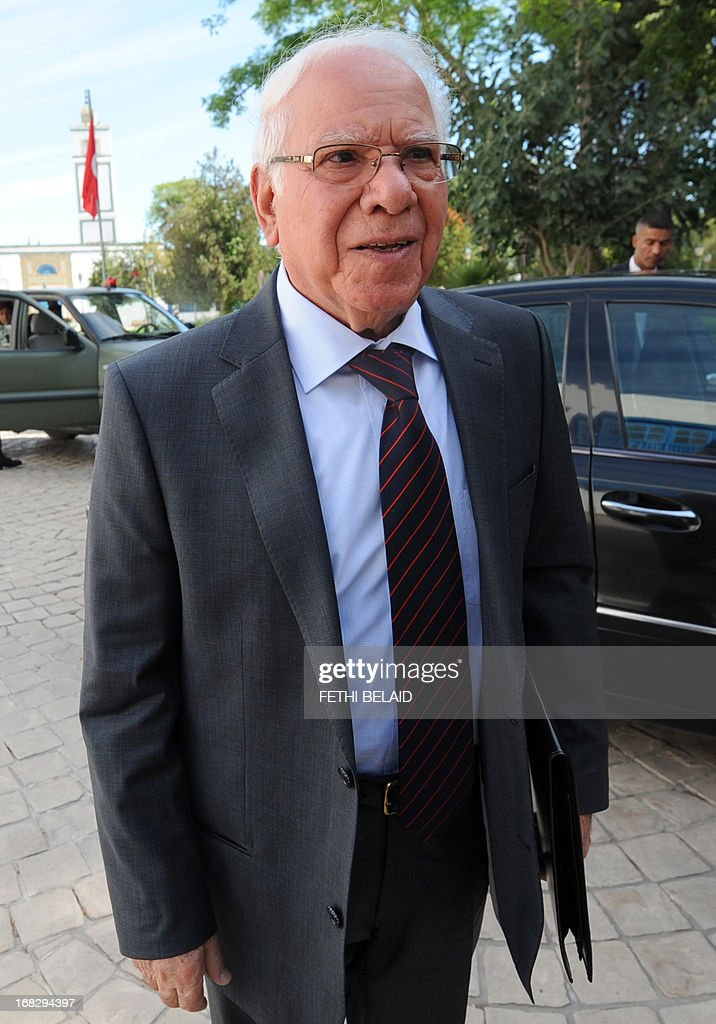 Tunisian Defence Minister Rachid Sabbagh arrives to attend a parliament session at the Constituent Assembly on May 8, 2013 in Tunis, on the security situation in Kasserine, the regional capital of the western region of Mount Chaambi, as soldiers continue their hunt for a jihadist group hiding out in the border region with Algeria. Tunisian Prime Minister Ali Larayedh insisted that Tunisia's security situation was improving and that fugitive jihadist groups with links to Al-Qaeda would be defeated. AFP PHOTO / FETHI BELAID