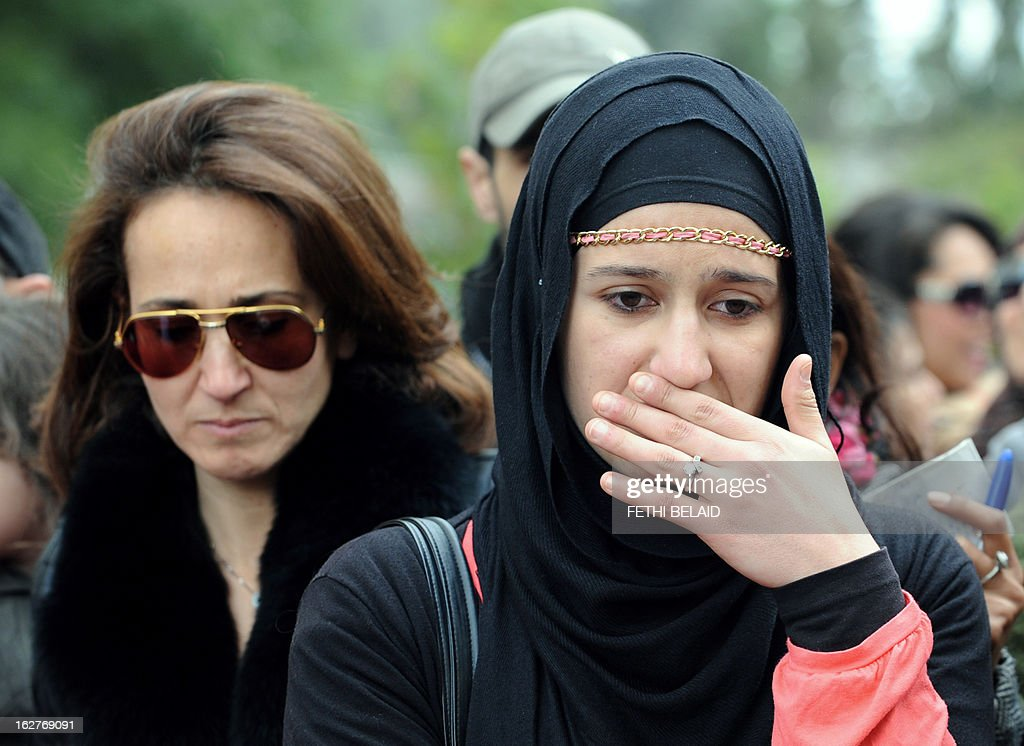 A Tunisian demonstrator cries at the site where Tunisian opposition leader Chokri Belaid was assassinated in Tunis, during an anti-government protest on February 26, 2013. Radical Salafist Muslims murdered Belaid, with four suspects arrested and the killer identified but still on the run, Interior Minister Ali Larayedh said.